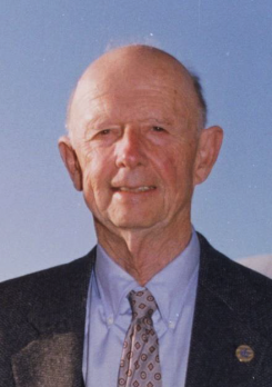 Portrait of Dr. Ward Motts in front of blue sky