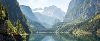Mountain lake among jagged peaks and alpine forest in Austria