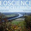 "The popular scene of the Connecticut River winding its way south through farm fields towards the profile of the Holyoke Range on a clear blue-sky day with the words ""GEOSCIENCES SENIOR CELEBRATION"" and hashtags mentioned in tasteful white and blue text hanging in clear blue sky."
