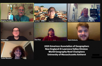 "Zoom screenshot of UMass Geography Club members with text: ""2020 American Association of Geographers New England-St Lawrence Valley Division World Geography Bowl Champions University of Massachusetts Amherst"