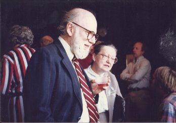 Scanned film photo of Dr. Jon Hubert with his late wife Mary-Alice at a party, looking to right outside frame, some time in the laye 1980's.