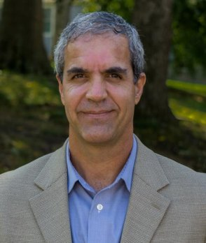 Headshot of Dr. Mike Rawlins in front of forested background