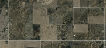 The agricultural landscape south of Clear Lake, Iowa. The light-colored patches in plowed fields are areas where dark-colored, organic-rich topsoil has been lost to erosion. Image courtesy GoogleEarth.