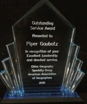 Photograph of crystal award presented to Dr. Gaubatz, with award text etched into crystal
