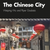 """Book Cover for """"The Chinese City"""" feturing title in white san-serif text over photograph of stone-paved courtyard festively hung with red, oblate, paper lanterns."""